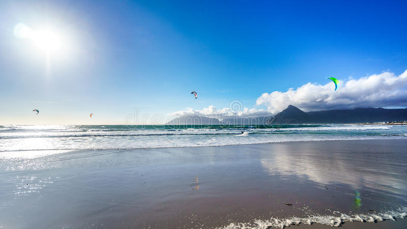 Kitesurfing at the beach community of Het Kommitjie near Cape Town. Kitesurfing at the beach community of Het Kommitjie on the Atlantic Ocean side of the Cape stock photography