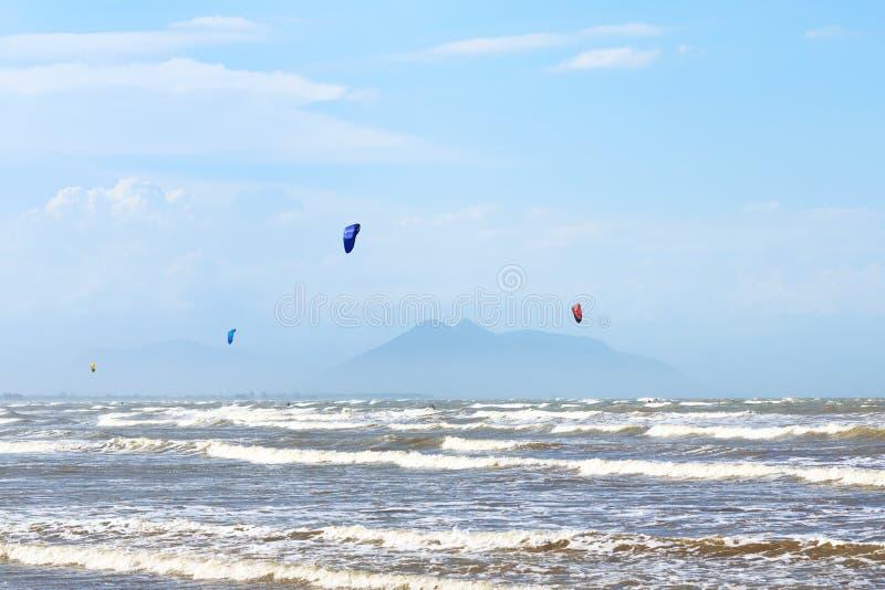Kitesurfing on beach Rasa in Armacao dos Buzios near Rio de Jane. Background: Kitesurfing on beach Rasa in Armacao dos Buzios near Rio de Janeiro, sea, waves royalty free stock images