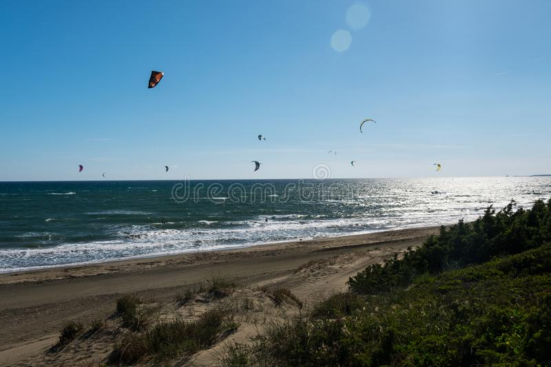 Kitesurfing at the beach. Summer sports. royalty free stock photography