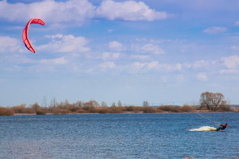 Kitesurfing in the flooded meadows during the high water on a bright sunny day. stock photo