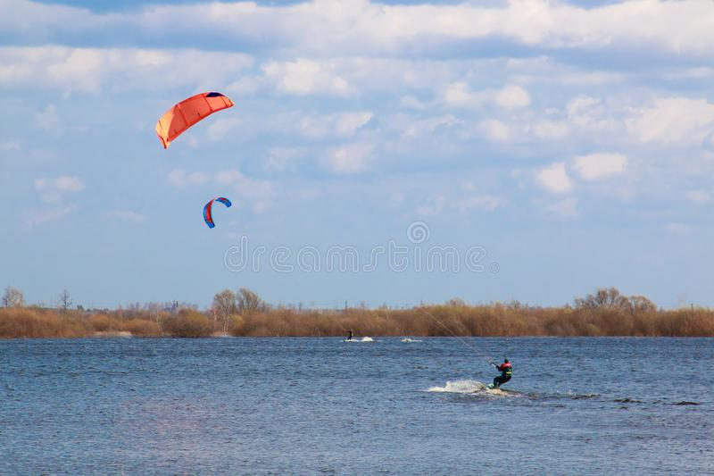 Kitesurfing in the flooded meadows during the high water on a bright sunny day. stock photography