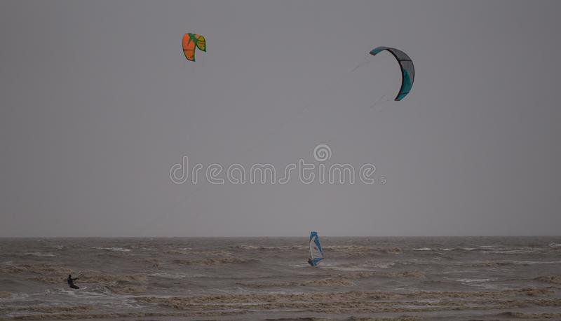 Weston Super Mare Kitesurfing. Kitesurfing in January 2019 in Weston Super Mare, United Kingdom. Waves on sea royalty free stock images