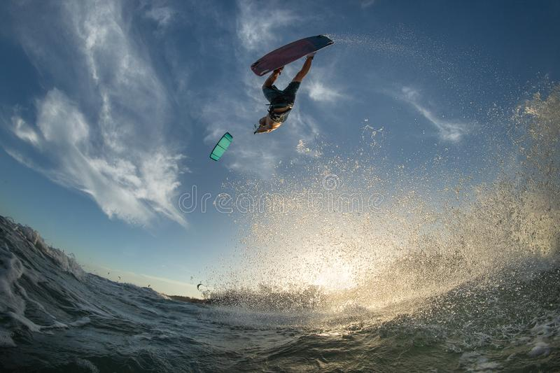 Kitesurfing. Kiteboarding action photos man among waves quickly goes stock images