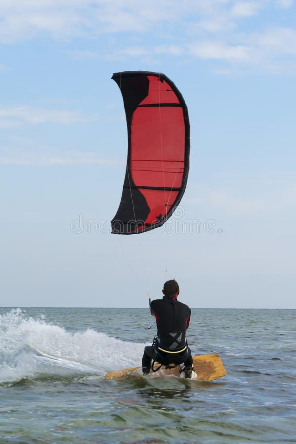 Kitesurfing Kiteboarding action photos man among waves quickly goes royalty free stock photos