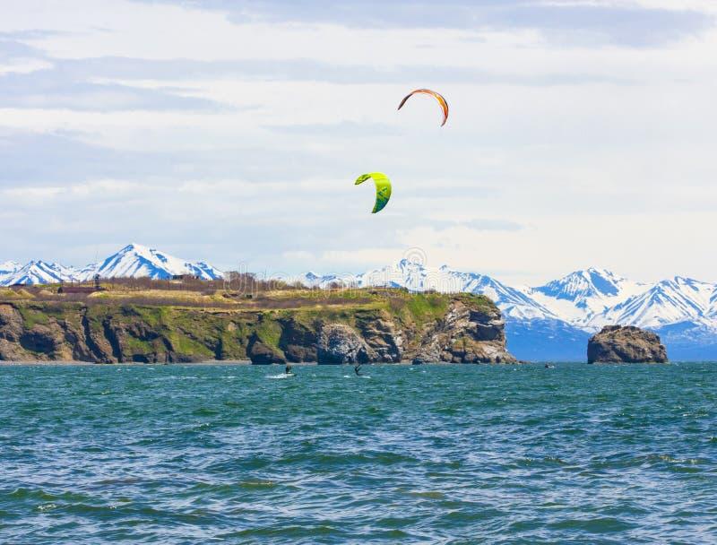 The Kitesurfing, kiteboarding, kite surf. Extreme sport kitesurfing in Kamchatka Peninsula in the Pacific ocean royalty free stock photo