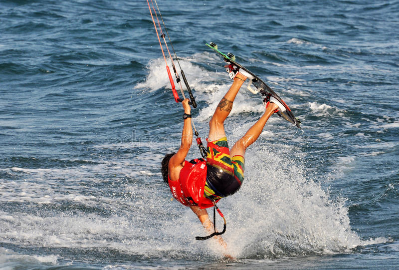 Kitesurfing in the Summer. A young man enjoying wind and waves at a competition in Cyprus royalty free stock image