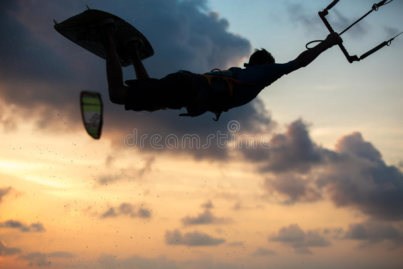 Kitesurfing. Various tricks done by rider on a kiteboard shot at sunset with beautiful backlit royalty free stock photos