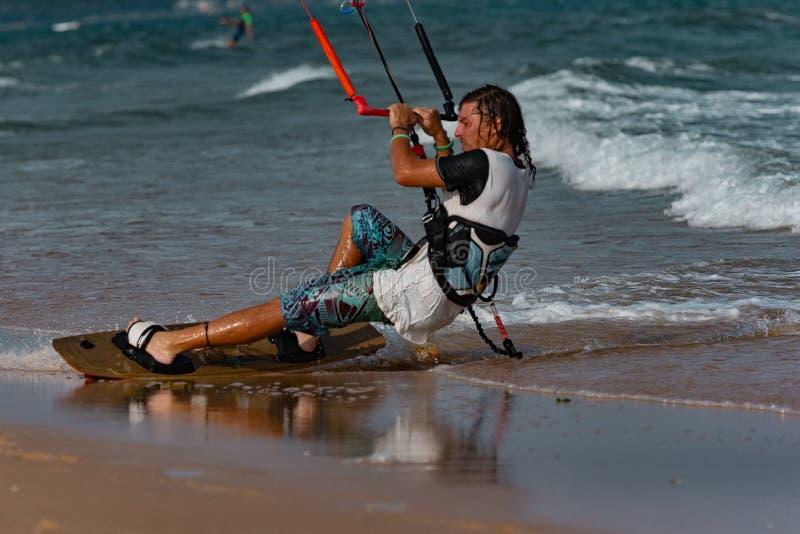 Kitesurfer In Action. Kitesurfing on the waves of the sea in Mui Ne beach, Phan Thiet, Binh Thuan, Vietnam. Kitesurfing, Kiteboarding action photos Kitesurfer In royalty free stock image