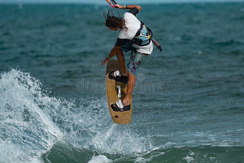Kitesurfer In Action. Kitesurfing on the waves of the sea in Mui Ne beach, Phan Thiet, Binh Thuan, Vietnam. Kitesurfing, Kiteboarding action photos Kitesurfer In royalty free stock photography