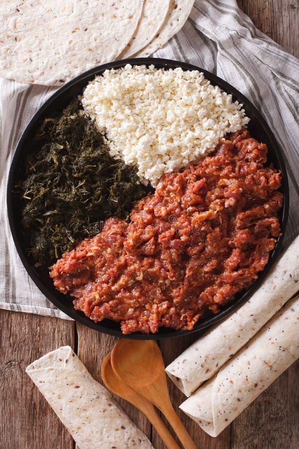 Kitfo etíope: carne de vaca adobada con las hierbas y el primer a del queso fotografía de archivo libre de regalías
