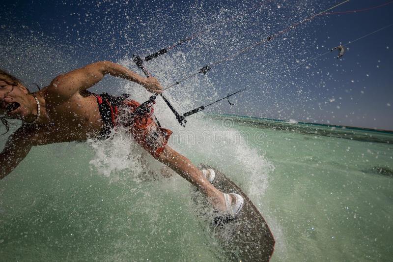 Kiting in Egypt. Kiter in sea spray. Head is outside the frame specially stock photo