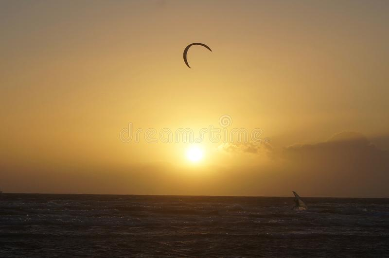 Kiting at sunset stock images