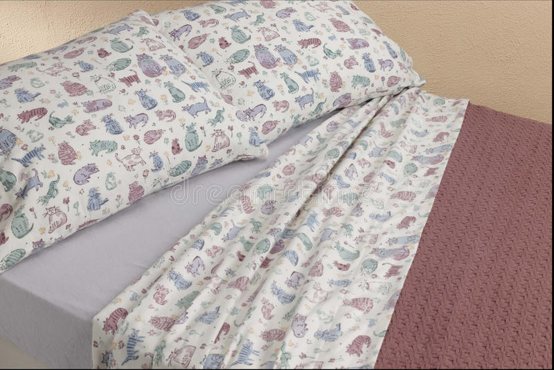 Kitty cat sheets on bed stock photography