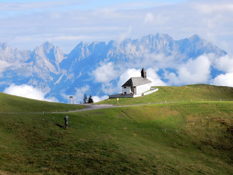 Kitzbuhel Alps – chapel, mountains, grasslands, clouds, Central Eastern Alps by town of Kitzbuhel - Tyrol - Austria. Kitzbühler Alpen - mountain range royalty free stock photos