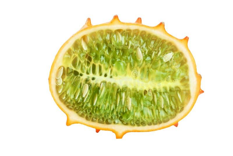 Kiwano eller horned melonhalva som isoleras på vit bakgrund royaltyfri foto