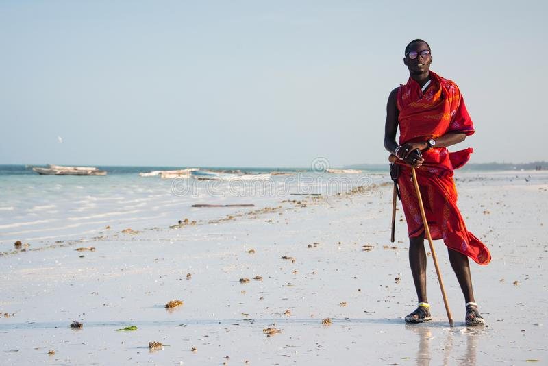 Portrait of masai man in traditional clothes, Kiwengwa, Zanzibar. KIWENGWA, ZANZIBAR - DEC 27, 2017: Portrait of masai man in traditional clothes posing on the stock photos