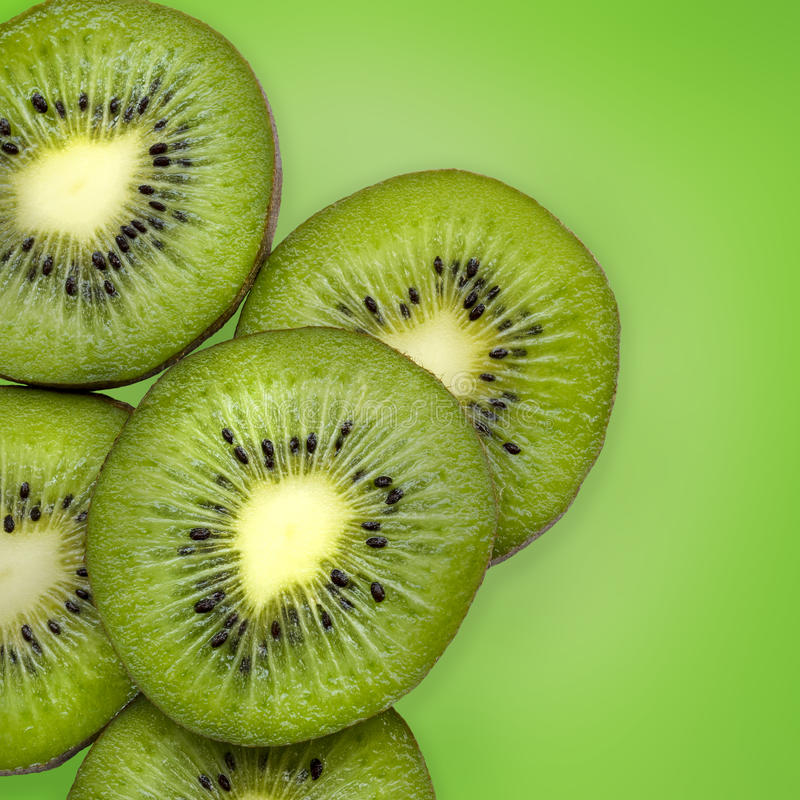 Kiwi. Fresh kiwi slices on green background stock photography