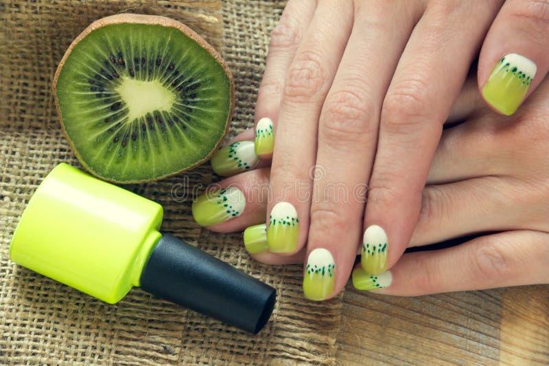 Kiwi art manicure royalty free stock images