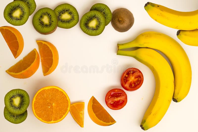 Kiwi banana tomato orange. With essential vitamins for healthy lifestyle. Colorful fresh group of fruits and vegetables for a balanced diet. White background royalty free stock photo