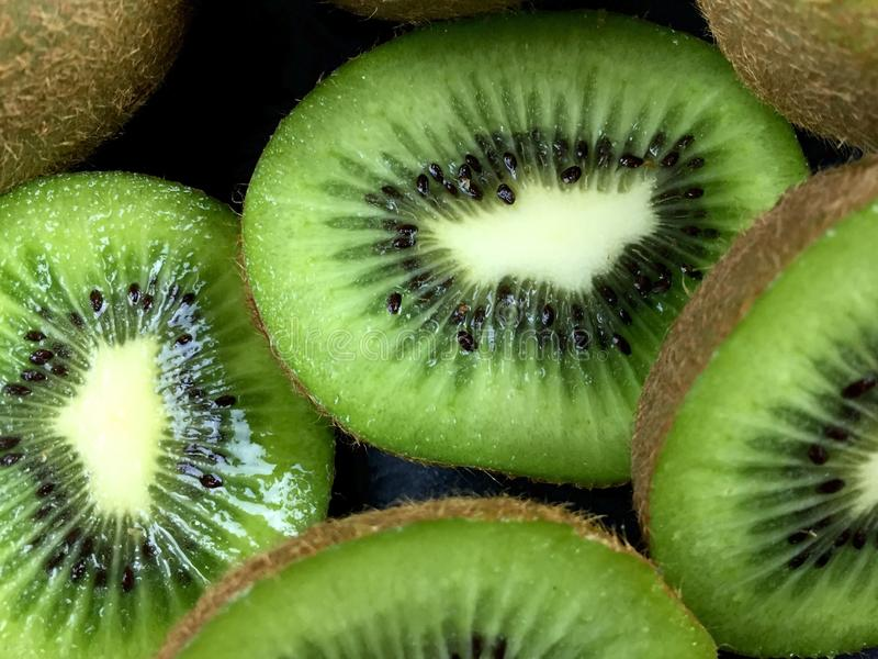 Kiwi. Close up of green kiwi halves and slices stock photo