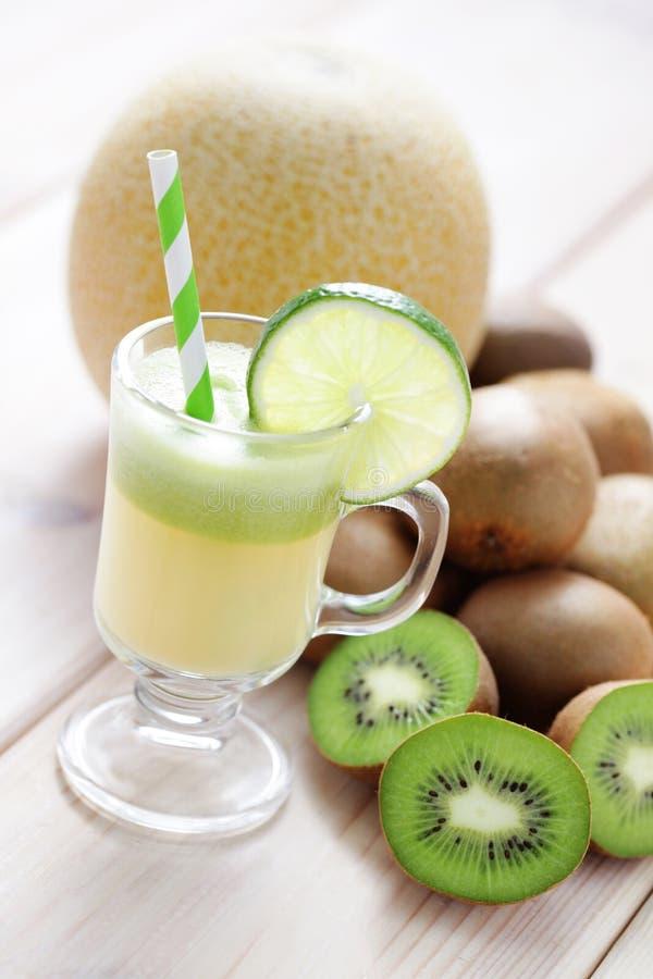 Kiwi en meloensap stock fotografie