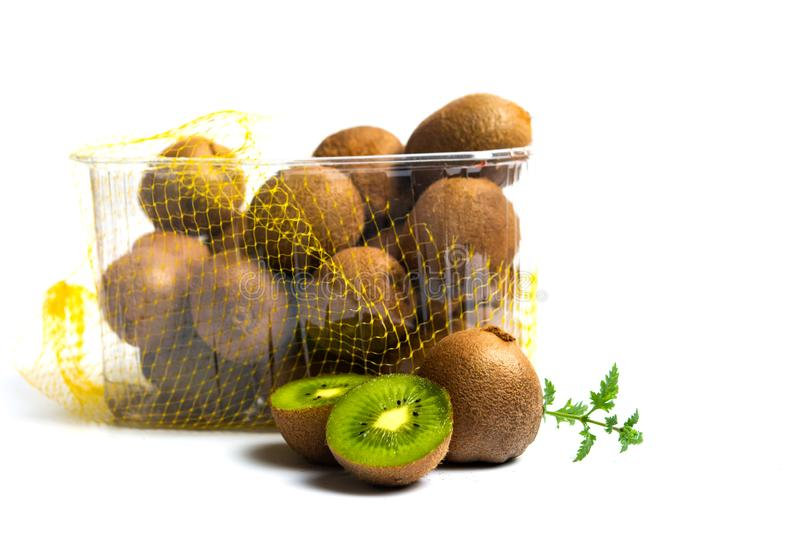 Kiwi fruit in a box isolated. On white kiwifruit package packed produced plastic wrap market top flat lay background slice green colorful view summer nature royalty free stock image
