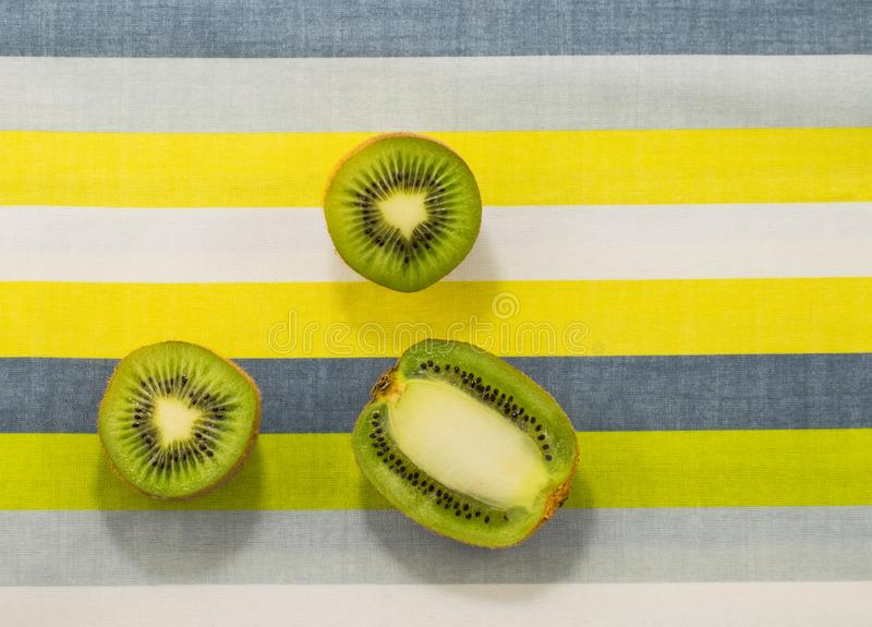 Kiwi fruit on on a bright background. Pop art style. Kiwi fruit on on a bright background. Pop art stock images