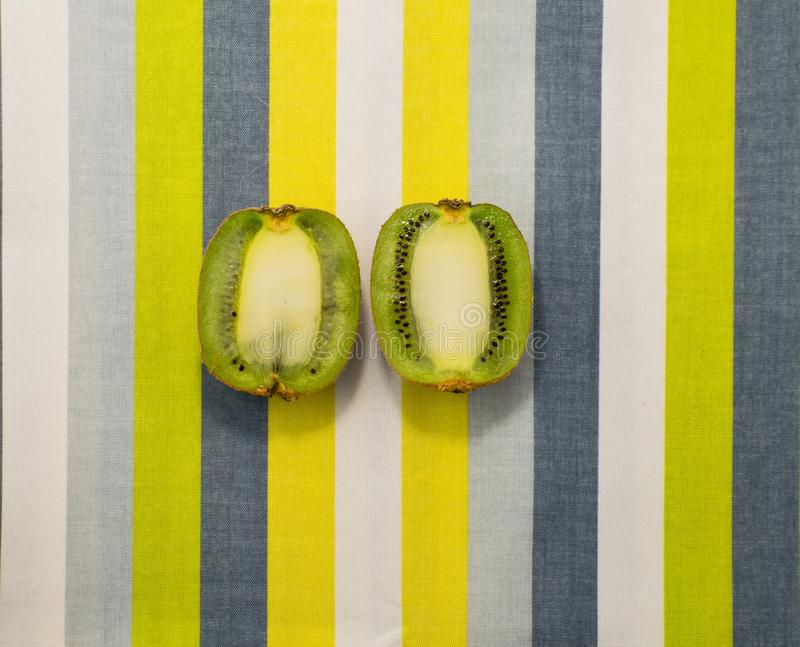 Kiwi fruit on on a bright background. Pop art style. Kiwi fruit on on a bright background. Pop art stock photos
