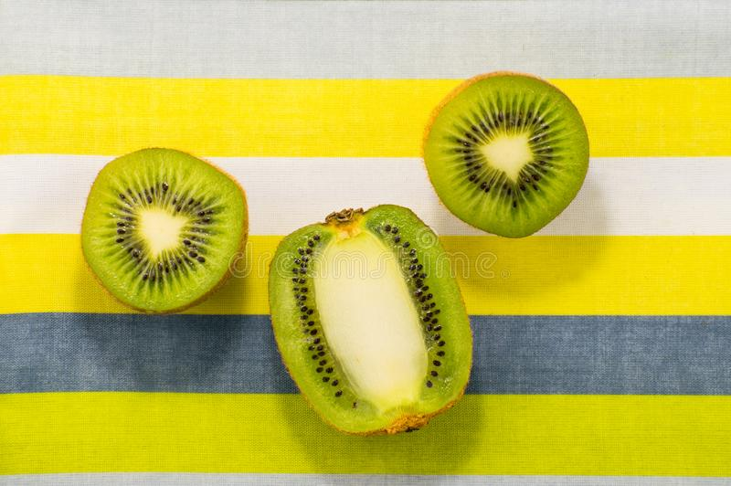 Kiwi fruit on on a bright background. Pop art style. Kiwi fruit on on a bright background. Pop art stock photo