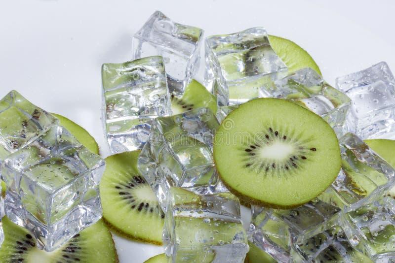 Kiwi fruit with ice royalty free stock images