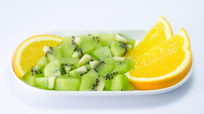 Kiwi fruit and orange slice. On white background royalty free stock image