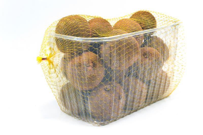 Kiwi fruit in plastic bowl stock image