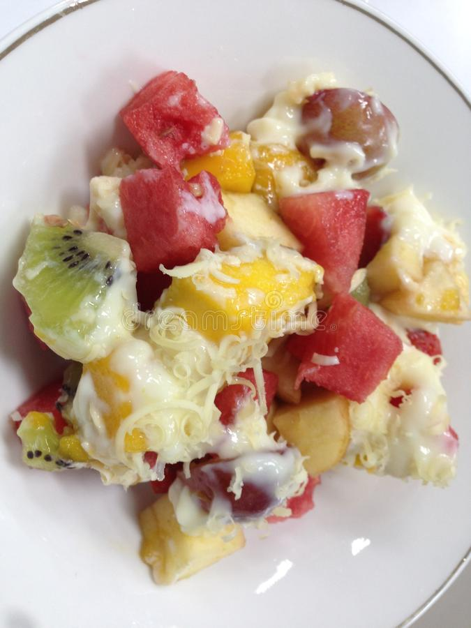 Kiwi fruit salad, watermelon, strawberries, mangoes, apples and melons royalty free stock photo