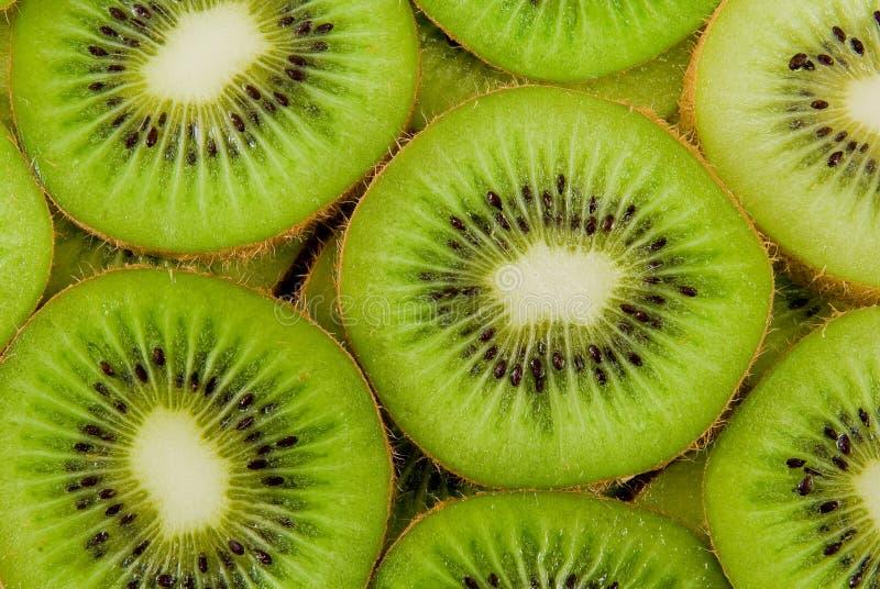 Kiwi fruit slices. Actinidia chinensis, Actinidia deliciosa are latin names of kiwi genus royalty free stock photos