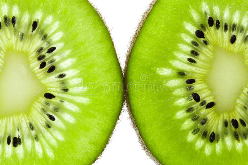 Kiwi fruit slices. Side by side (chinese gooseberry stock photos