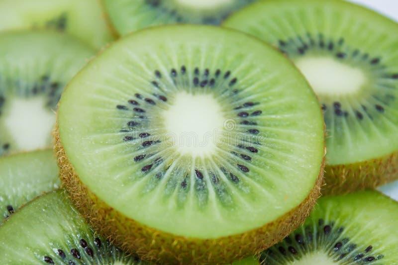 Kiwi fruit slices background. Beautiful kiwi fruit slices background royalty free stock photography