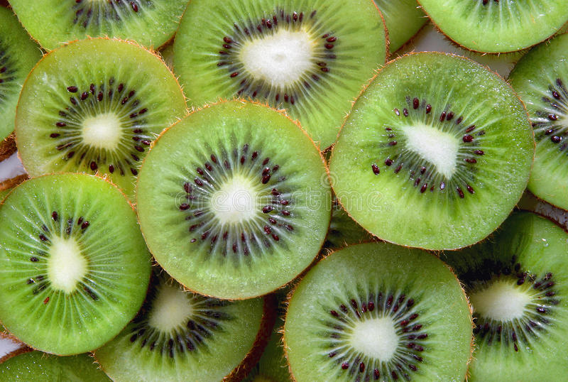 Kiwi fruit slices. Green colorful pattern of sliced kiwi fruit royalty free stock photography