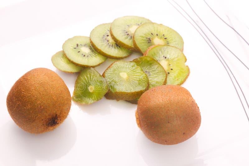 Kiwi fruit and slices stock photos