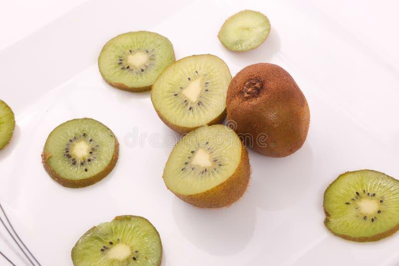 Kiwi fruit and slices royalty free stock photos