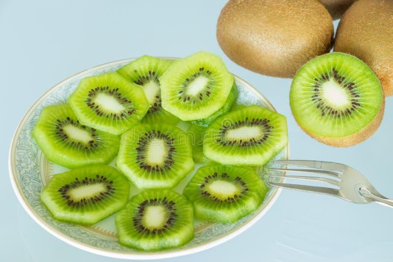 Kiwi fruit. Kiwi slices on a plate royalty free stock photography