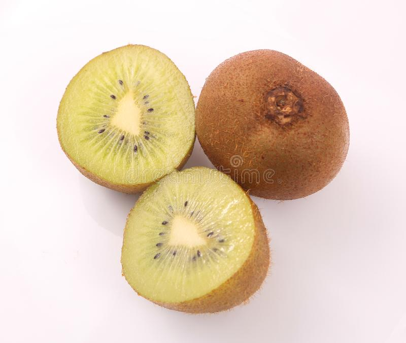 Kiwi fruit on white. Kiwi fruit with kiwi slices on a white background stock photography