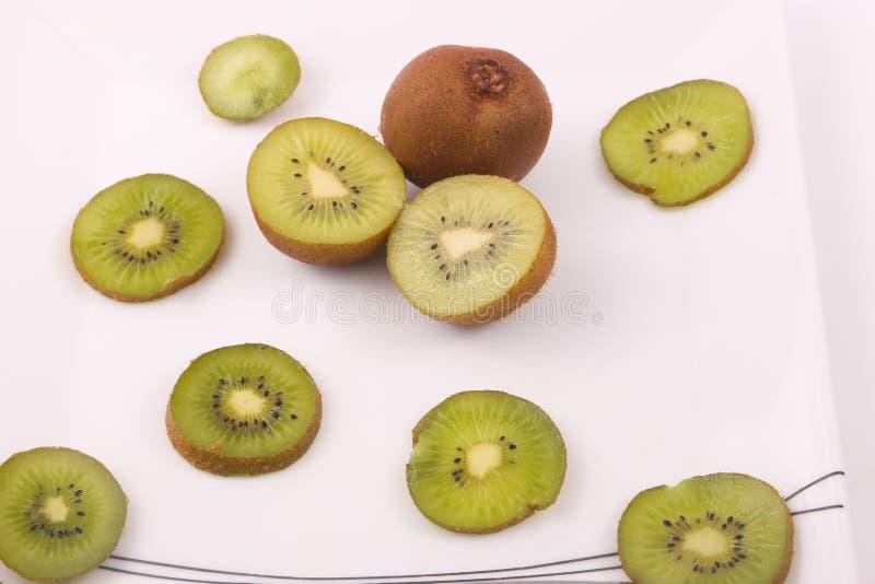 Kiwi fruit on white. Kiwi fruit with kiwi slices on a white background stock photo