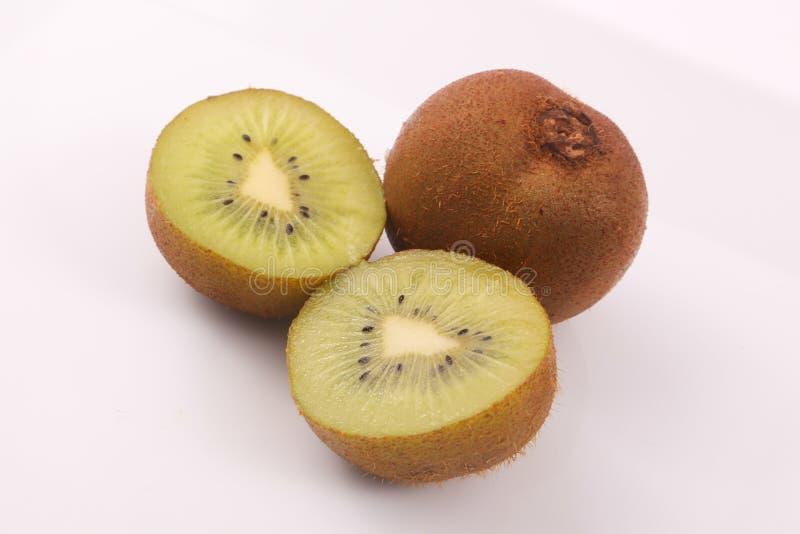 Kiwi fruit on white. Kiwi fruit with kiwi slices on a white background royalty free stock images