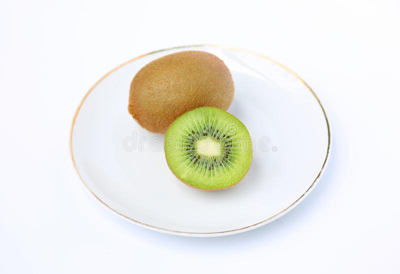 Kiwi fruit in white plate royalty free stock image