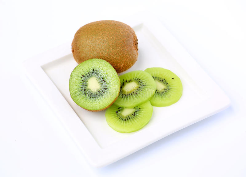 Kiwi fruit in white plate stock photography