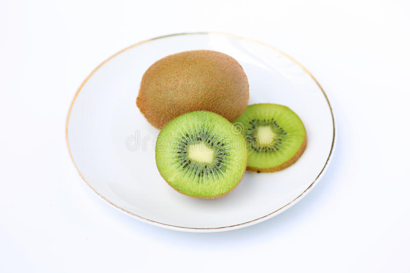Kiwi fruit in white plate royalty free stock photo