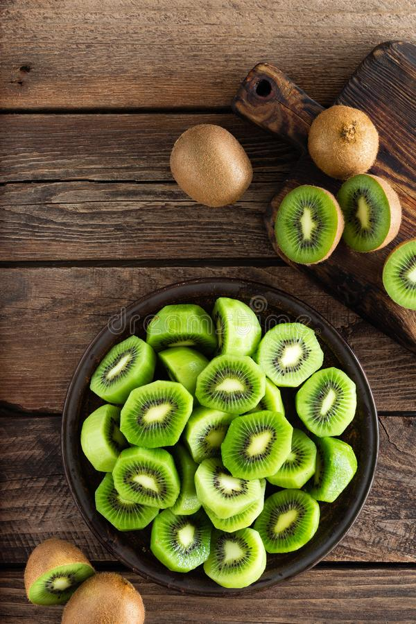 Kiwi fruit on wooden rustic table, ingredient for detox smoothie royalty free stock images