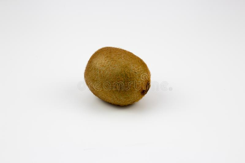 A kiwi fruits on background. A fresh, healthy, ripe kiwi fruits on white background. multiple uses are possible stock images