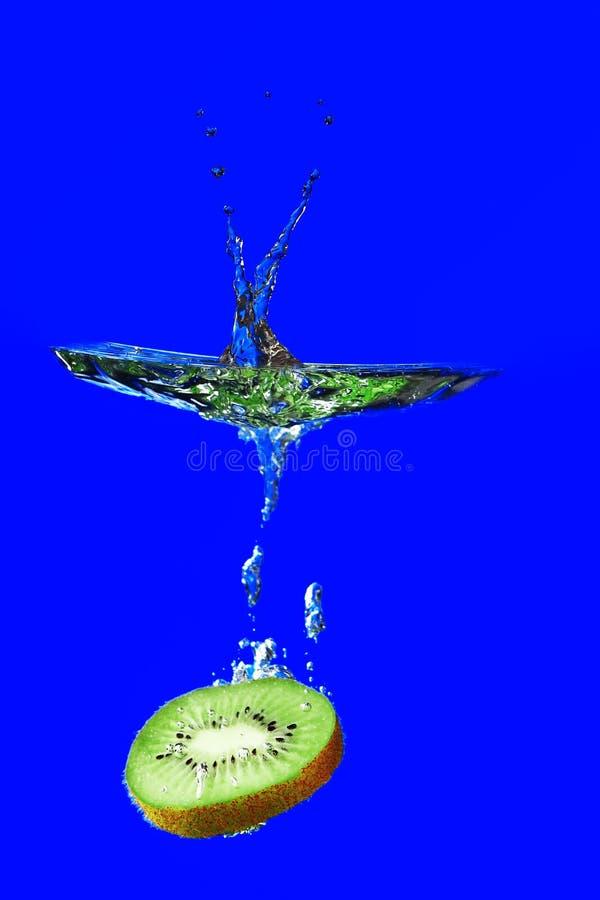 Kiwi, kiwi fruit falling into the water