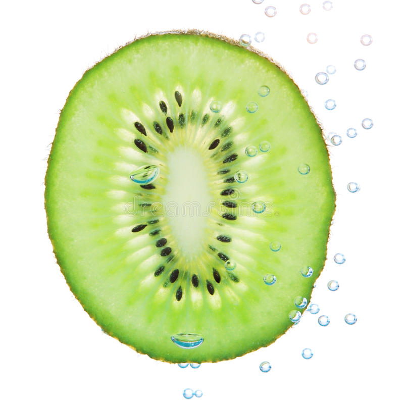 Download Kiwi In A Liquid With Bubbles. Stock Image - Image: 24333013